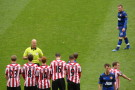 Quelle: http://upload.wikimedia.org/wikipedia/commons/b/b8/SAFC_v_MUFC_Wayne_Rooney_free_kick.jpg