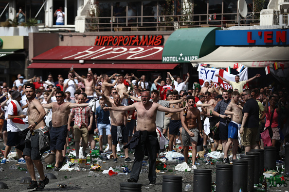 MARSEILLE, FRANCE - JUNE 11: Rubbish lines the streets as England fans gather, cheer and clash with police ahead of the game against Russia later today on June 11, 2016 in Marseille, France. Football fans from around Europe have descended on France for the UEFA Euro 2016 football tournament. (Photo by Carl Court/Getty Images)