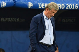 England's coach Roy Hodgson reacts during the Euro 2016 round of 16 football match between England and Iceland at the Allianz Riviera stadium in Nice on June 27, 2016. / AFP / BERTRAND LANGLOIS        (Photo credit should read BERTRAND LANGLOIS/AFP/Getty Images)