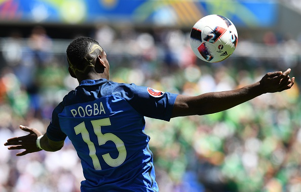 TOPSHOT - France's midfielder Paul Pogba plays the ball during the Euro 2016 round of 16 football match between France and Republic of Ireland at the Parc Olympique Lyonnais stadium in Décines-Charpieu, near Lyon, on June 26, 2016. / AFP / FRANCK FIFE (Photo credit should read FRANCK FIFE/AFP/Getty Images)
