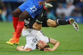 MARSEILLE, FRANCE - JULY 07:  Thomas Mueller of Germany battles for the ball with Samuel Umtiti of France during the UEFA EURO 2016 semi final match between Germany and France at Stade Velodrome on July 7, 2016 in Marseille, France.  (Photo by Alexander Hassenstein/Getty Images)